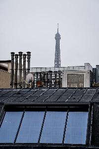 rooftop with view of the Eiffel Tower from a 2-bedroom paris luxury apartment