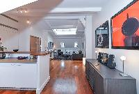 modern well-equipped kitchen and charming living area of a 2-bedroom paris luxury apartment