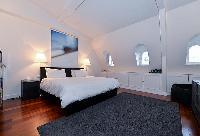modern and elegant master bedroom in paris luxury apartment