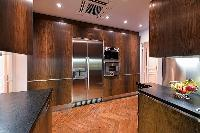 modern well-equiped kitchen in a 3-bedroom paris luxury apartment