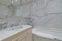 bathroom with marble lavatory and bathtub in paris luxury apartment