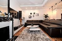 sleek and beautiful lightings in both living and dining area in a 2-bedroom Paris luxury apartment