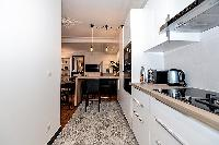 fully-equipped kitchen in a 2-bedroom Paris luxury apartment