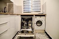 fully-equipped kitchen, a washer, and a dryer in a 2-bedroom Paris luxury apartment
