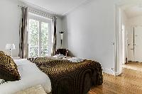 second bedroom with 2 single beds facing the courtyard in paris luxury apartment
