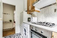 fully-equipped kitchen in paris luxury apartment