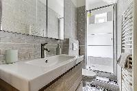 single, contemporary, renovated bathroom with a shower and toilet in paris luxury apartment