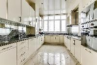 modern fully-equipped kitchen in a 4-bedroom Paris luxury apartment