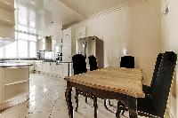 another table for food preparation in a 4-bedroom Paris luxury apartment