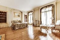 spacious master bedroom with large and comfortable queen-sized bed, television, small drawer in a 4-