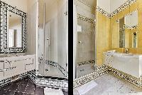 elegant en-suite bathroom with bathtub, lavatory, and full toilet in a 4-bedroom Paris luxury apartm
