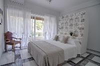 awesome bedroom with balcony at Rome Vatican I luxury apartment