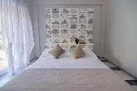 pristine bed sheets and pillows in Rome Vatican I luxury apartment