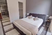 crisp and clean bedroom linens in Rome Vatican I luxury apartment
