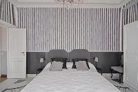 fresh and clean bedroom linens in Rome Vatican I luxury apartment luxury apartment
