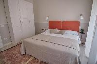 clean and fresh bedroom linens in Rome Vatican I luxury apartment luxury apartment