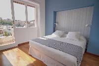 cool bedroom with balcony at Rome Vatican I luxury apartment luxury apartment