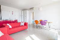 candy-colored chairs in Cannes - Barri luxury apartment