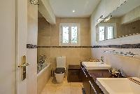 elegant bathroom with tub in Cannes - Mahtari luxury apartment