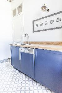 bool blue kitchen theme in Cannes - Pere Muret luxury apartment