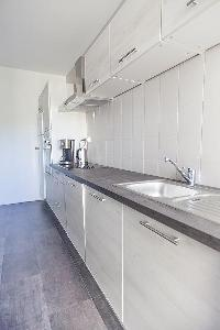 neat kitchen cabinets in Cannes - Soleil luxury apartment