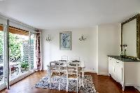 dining room with a mirror, square-shaped table and seats for 4, and balcony with a coffee table for
