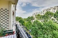 views outside from the wide and bright balcony in a 1-bedroom Paris luxury apartment