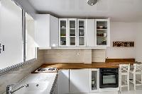 spacious well-equipped kitchen in a 1-bedroom Paris luxury apartment