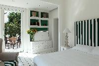 pristine bed sheets and pillows in Villa Dei D'Armiento luxury apartment