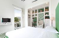 pristine pillows and bed sheets in Villa Dei D'Armiento luxury apartment