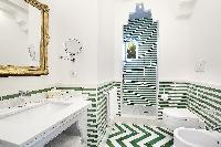 awesome bathroom tiles in Villa Dei D'Armiento luxury apartment