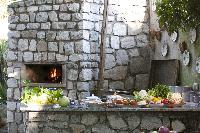 impressive outdoor pizza oven in Villa Dei D'Armiento luxury apartment