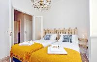 neat and nice bed sheets and pillows in Rome - Charming Dante 3BR luxury apartment