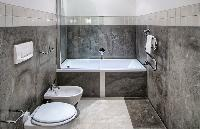 cool bathroom with tub in Rome - Colosseum View 5BR luxury apartment