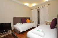 crisp and clean bedroom linens in Rome - Cavour Colosseum luxury apartment