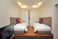 pristine bed sheets and pillows in Rome - Colosseum 2BR luxury apartment