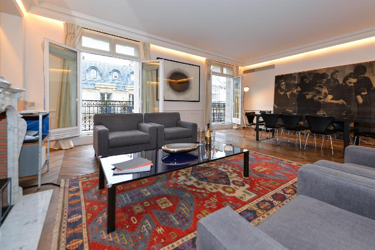 elegant living room with comfortable furniture, modern furnishings, and beautiful carpetry  in paris