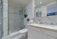 bathroom with marble lavatory, shower, and toilet in a 5-bedroom paris luxury apartment