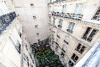 courtyard view from the French window in paris luxury apartment