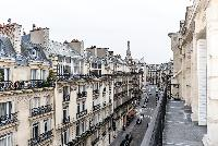 view from the balcony overlooking the city in paris luxury apartment