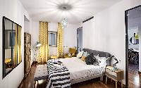 pristine bed sheets and pillows in Rome - Charming Urbana Colosseum luxury apartment
