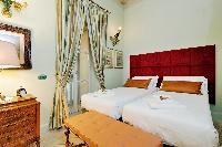 clean and crisp bedroom linens in Rome - Boccaccio Trevi Fountain 2BR luxury apartment