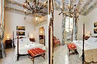 crisp and clean bedroom linens in Rome - Boccaccio Trevi Fountain 2BR luxury apartment