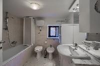 neat and trim bathroom in Rome - Clementina Colosseum 1BR luxury apartment