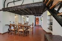 delightful dining room of Rome - Clementina Colosseum 1BR luxury apartment