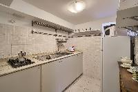delightful modern kitchen of Rome - Clementina Colosseum 1BR luxury apartment