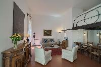 delightful living room of Rome - Clementina Colosseum 1BR luxury apartment