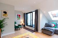 cool glass doors to the patio of London Hanbury Street 2BR luxury apartment