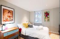 spacious bedroom in London Hanbury Street 2BR luxury apartment