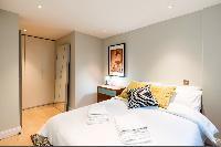 plush, large bed in London Hanbury Street 2BR luxury apartment